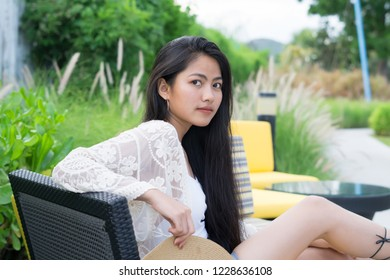 Beautiful asian girl relaxing on a resort