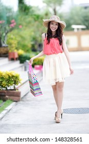 Beautiful asian girl is shopping