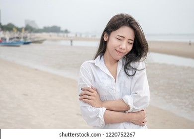 Beautiful Asian girl smiling hug herself, concept for love yourself.