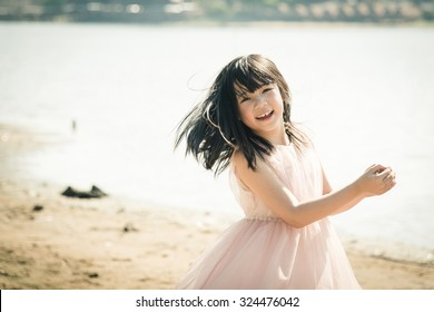 Beautiful asian girl smiling on the beach,Vintage filter