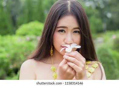 Beautiful Asian girl in Thai traditional dress costume , Asian Woman in Traditional Costume of Thailand.