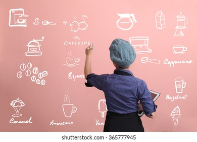 Beautiful Asian girl writing coffee menu on pink wall