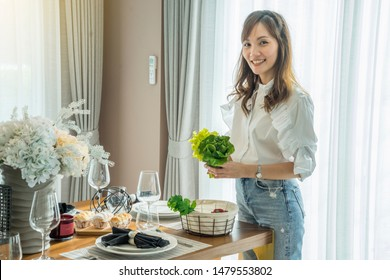 Beautiful Asian girls prepare clean food salads for diner  party in the house.Health food and party concept