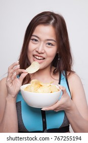 Beautiful Asian healthy girl  eat potato chips on white background