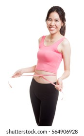 Beautiful Asian healthy girl measuring her waist  isolated on white background.