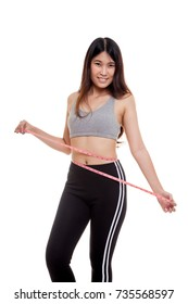 Beautiful Asian healthy girl measuring her waist isolated on white background