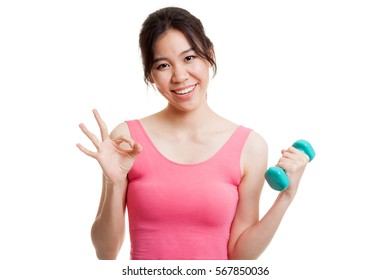 Beautiful Asian healthy girl show OK with dumbbell  isolated on white background.