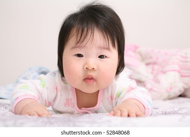 Beautiful Asian Infant Baby on Belly