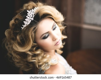 beautiful asian lady in evening dress and diadem