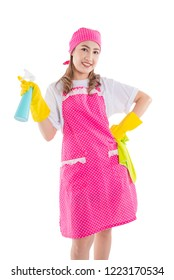 Beautiful asian maid in pink apron isolated over white background