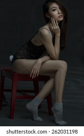 Beautiful asian model on red chair wearing lingerie