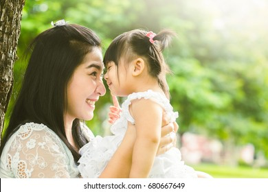 Beautiful asian mom and baby playing happiness in the park , outdoor ,mother day concept
