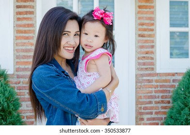 Beautiful Asian mother with her daughter