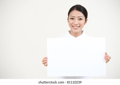 beautiful asian nurse holding a blank whiteboard