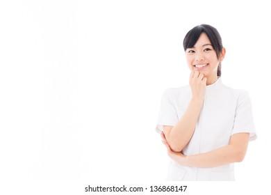 a beautiful asian nurse thinking on white background