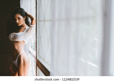 Beautiful asian sexy woman with long hair fashion posing in white underwear,vintage tone.
