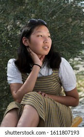 Beautiful Asian teenage female with smile. Natural beauty concept. Mongolian young girl.