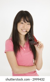 Beautiful Asian teenager on white background