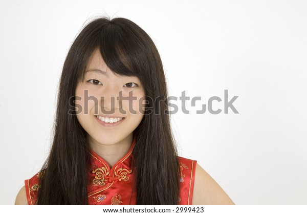 Beautiful Asian teenager in traditional dress on blue background