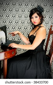 Beautiful Asian Victorian Young Woman With Top Hat Pointing At A Laptop Computer, What Is Technology