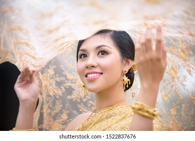 Beautiful asian with welcome expression. Beauty fantasy Thai woman. Beautiful Thai girl in traditional dress costume