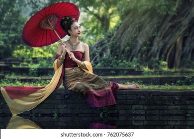Beautiful asian with welcome expression. Beauty fantasy Thai woman. Beautiful Thai girl in traditional dress costume, Ayutthaya province, Thailand.