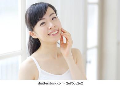 Beautiful asian woman in the bathroom