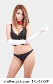 beautiful asian woman in black bikini costume portrait with red tie in studio