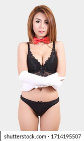 beautiful asian woman in black bikini costume portrait with red tie in studio