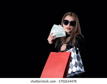 Beautiful Asian woman in a black suit Being happy by holding money after to go shopping