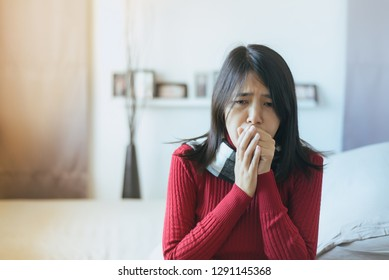Beautiful asian woman coughing with sore throat,Female suffering with cough a lot in bedroom