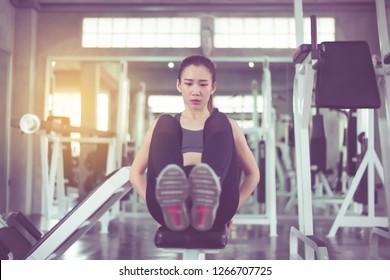 Beautiful asian woman doing situp or crunches in gym,Female exercise muscular her stomach