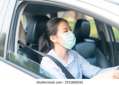Beautiful Asian woman driving car wearing facemask going outside stay healthy protective from coronavirus covid-19 virus infection disease outbreak world pandemic, traffic air pollution emission