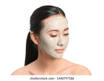 Beautiful Asian woman with facial mask on white background