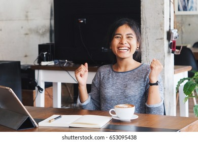 Beautiful Asian woman feeling excited with something on her laptop,successful woman working concept