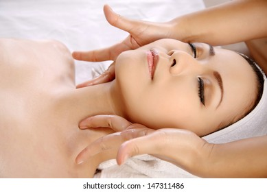 Beautiful asian woman get facial massage on the spa