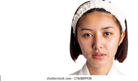Beautiful asian woman gets freckles, and dull skin on her face. Pretty young woman get problems of facial skin. She looks unhappy. isolated on white, copy space. Asia lady get bare face no makeup