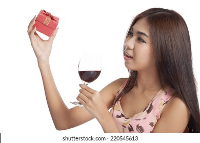 Beautiful Asian woman with gift box and red wine  isolated on white background