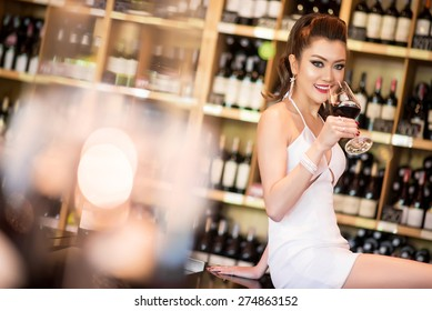 Beautiful asian woman with a glass of wine