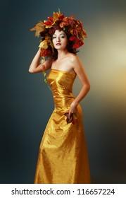 beautiful asian woman in golden dress. Quin autumn