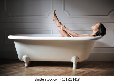 Beautiful Asian woman having a bath.