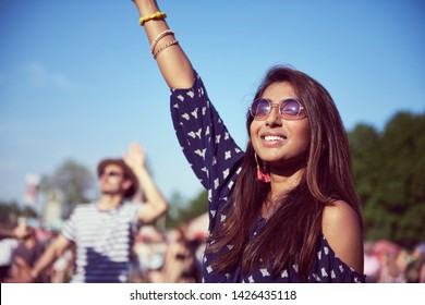 Beautiful Asian woman having great fun at music festival