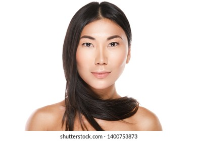 Beautiful asian woman with a healthy black hair on white background