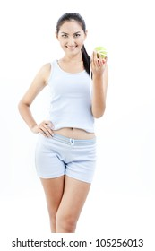 Beautiful asian woman hold apple and measuring tape in her hand on white background