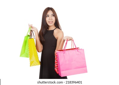 Beautiful Asian woman hold shopping bags look away  isolated on white background