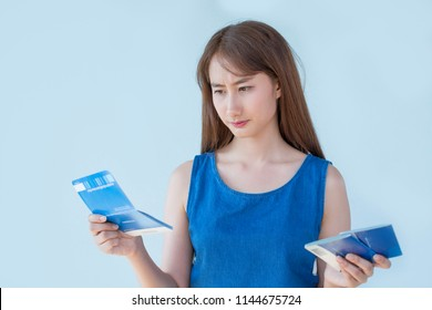 Beautiful Asian Woman are holding account book on blue background ,disappointed with saving money, saving concept.
