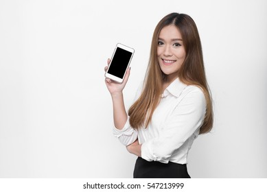 Beautiful Asian woman holding blank screen smartphone on white background
