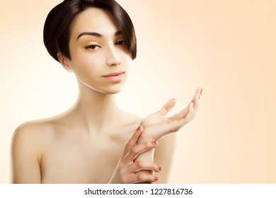 beautiful asian woman holding hands for product