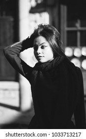 Beautiful Asian woman holding her hair. Black and white image.
