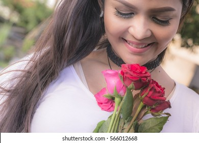 Beautiful asian woman holding a rose, Love concept, Valentine theme